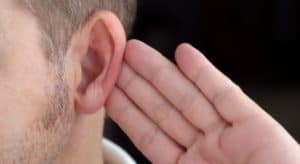 closeup of man putting his hand behind his ear