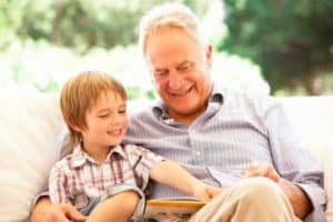 grandfather reading with grandson
