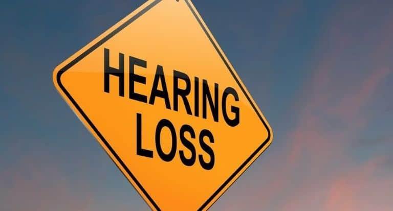 Street sign with Hearing Loss written across it