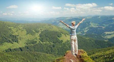 Woman enjoying the views on top of a mountain