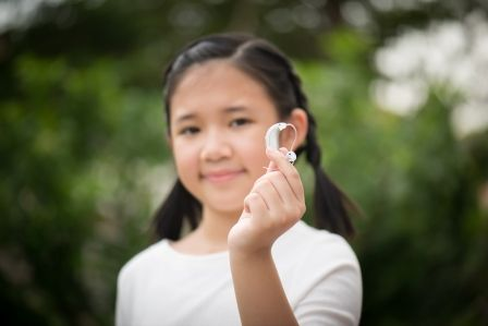 Pediatric hearing aids have come a long way. Unobtrusive