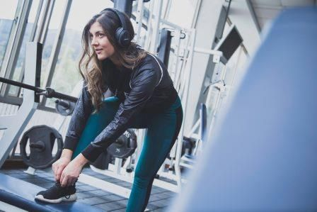 woman ready to get on the treadmill at the gym