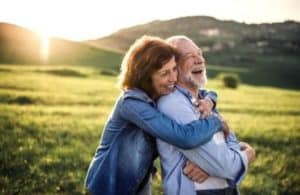 mature couple in an embrace at dawn