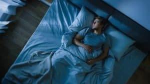man in bed asleep
