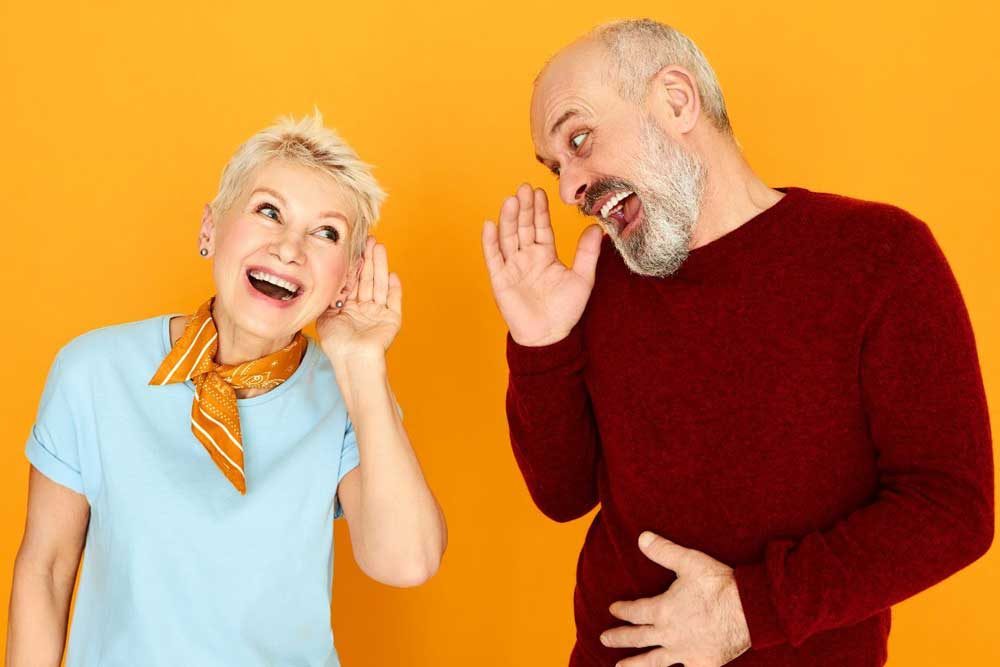 Man and woman with hearing difficulty laughing