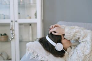 woman resting with headphones on